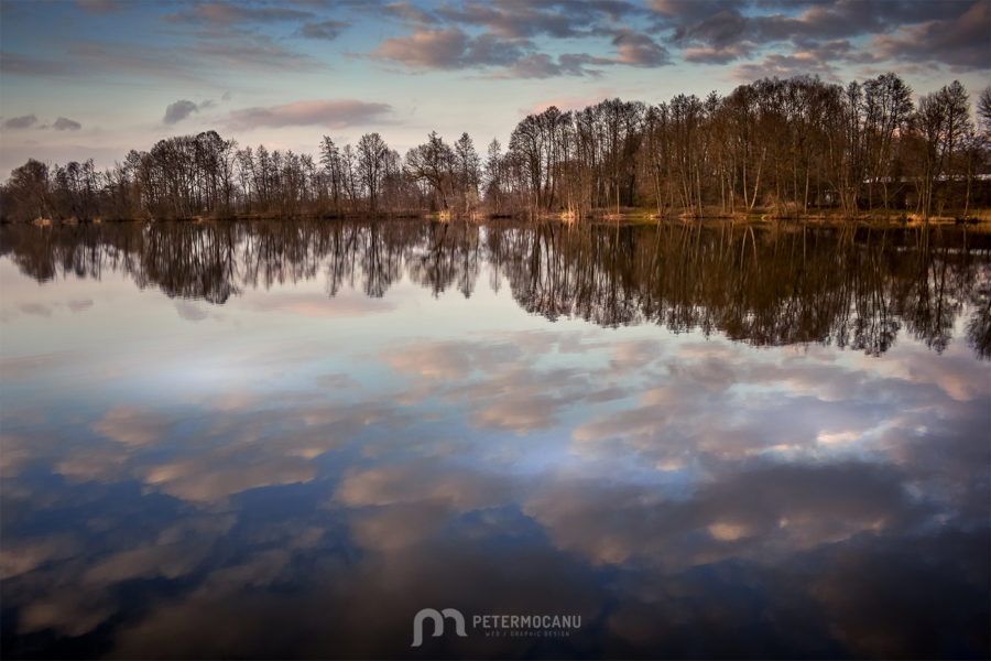 Landscape Photography of a Lake with reflections of a cloudy sky